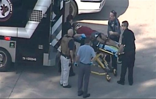 In this frame grab provided by KPRC Houston, an unidentified person is transported by emergency personnel at Lone Star College Tuesday, Jan. 22, 2013, in Houston. (AP Photo/Courtesy KPRC TV)