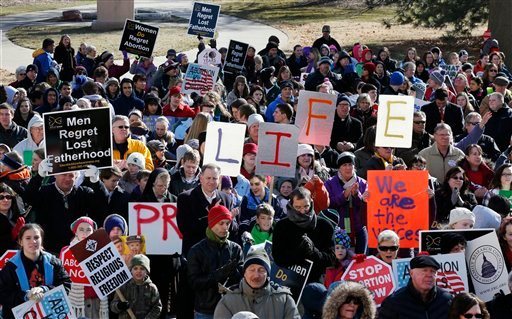 Abortion opponents rally at the steps of the Kansas Statehouse in Topeka, Kan., Tuesday, Jan. 22, 2013. (AP Photo/Orlin Wagner)
