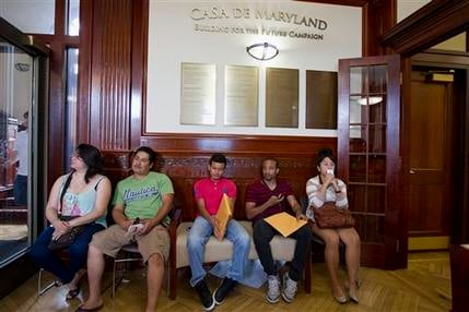 Aug. 15, 2012 file photo: Applicants waiting in Casa de Maryland in Langley Park, Md., before they can apply for the Deferred Action Childhood Arrivals. (AP Photo/Jose Luis Magana, File)
