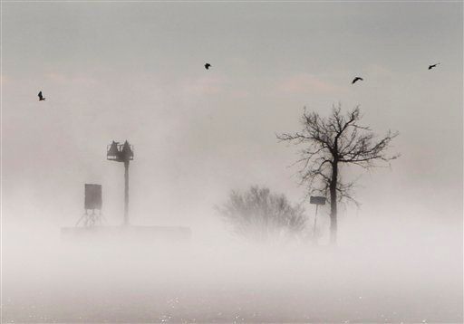 Fog gathers over Lake Winnebago during a stretch of bitter cold weather Tuesday Jan. 22, 2013, in Menasha, Wis. The upper Midwest is in a third straight day of bitter cold temperatures. (AP Photo/The Post-Crescent, William Glasheen)