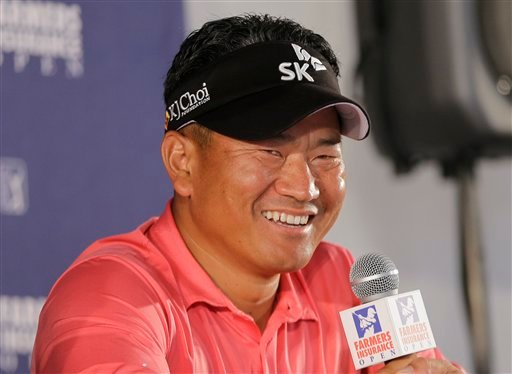 K.J. Choi, of South Korea, smiles in the interview room after hitting a seven-under-par 65 during the first round of the Farmers Insurance Open golf tournament on Thursday, Jan. 24, 2013, in San Diego.