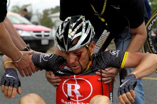 In this May 20, 2010 file photo, U.S. cyclist Lance Armstrong is helped up after crashing during the fifth stage of the Tour of California cycling race on the outskirts of Visalia, Calif. (AP Photo/Marcio Jose Sanchez, File)