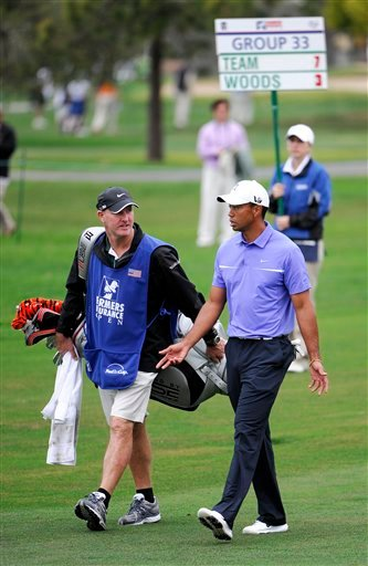 Tiger Woods, right, talks with his caddie Joe LaCava, left, during his round in the Pro-Am at the Farmers Insurance Open golf tournament at Torrey Pines on Wednesday, Jan 23, 2013 in San Diego.