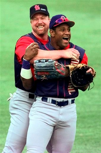In this July 12, 1999, file photo, St. Louis Cardinals' Mark McGwire, left, hugs Chicago Cubs' Sammy Sosa in the outfield at Fenway Park during a workout for baseball's All-Star Game in Boston.