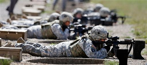 FILE - In this Sept. 18, 2012 file photo, female soldiers from 1st Brigade Combat Team, 101st Airborne Division train on a firing range while testing new body armor in Fort Campbell, Ky., in preparation for their deployment to Afghanistan. (AP)