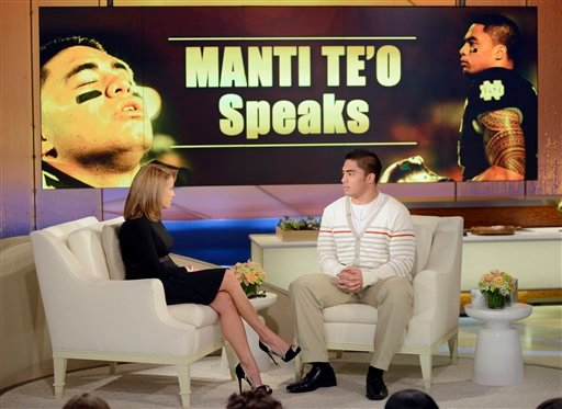 "In this photo taken on Jan. 22, 2013 and released by ABC Notre Dame linebacker Manti Te'o, right, speaking with host Katie Couric during an interview for ""Katie,"" in New York. (AP Photo/Disney-ABC, Lorenzo Bevilaqua)"