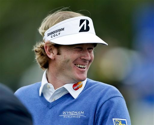 © Brandt Snedeker sports a big smile on the fourth hole on the North Course at Torrey Pines during the first round of the Farmers Insurance Open golf tournament Thursday, Jan. 24, 2013, in San Diego.