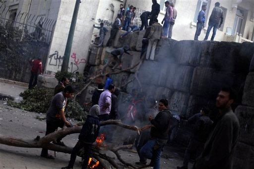 © Skirmishes break out between protesters and security forces, unseen, near Tahrir Square, Cairo, Egypt, Friday, Jan. 25, 2013.
