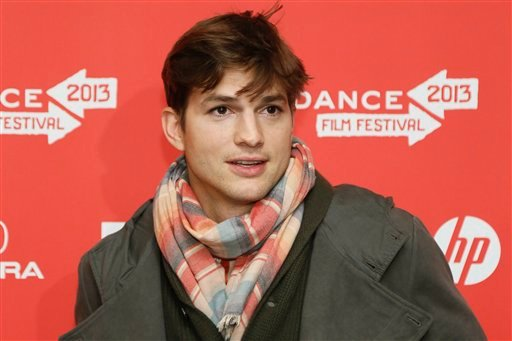 """© Actor Ashton Kutcher, who portrays Apple's Steve Jobs in the film """"jOBS,"""" poses at its premiere during the 2013 Sundance Film Festival on Friday, Jan. 25, 2013 in Park City, Utah. (Photo by Danny Moloshok/Invision/AP)"""