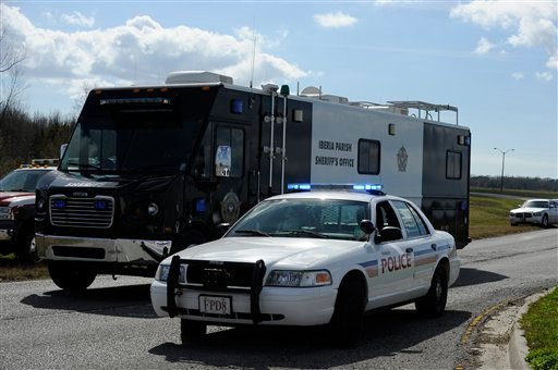 © An Iberia Parish Sheriff's Office command post is driven to the scene of a shooting Saturday, Jan. 26, 2013 in Charenton, La.