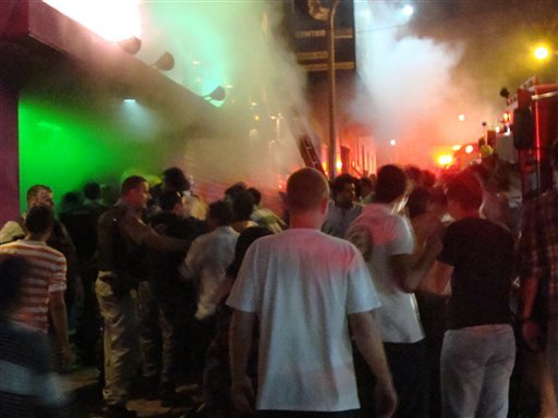 © A crowd stands outside the Kiss nightclub during a fire inside the club in Santa Maria city, Rio Grande do Sul state, Brazil, Sunday, Jan. 27, 2013.