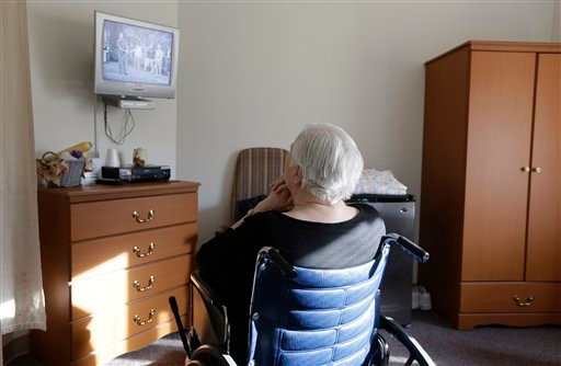 "© An elderly woman who has suffered abuse by a relative watches ""I Love Lucy"" on a television inside her room at Cedar Village retirement community, Tuesday, Jan. 8, 2013, in Mason, Ohio."