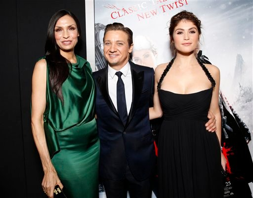 "© Famke Janssen, Jeremy Renner and Gemma Arterton arrive at the premiere of ""Hansel & Gretel Witch Hunters"" on Thursday Jan. 24, 2013, in Los Angeles. (Photo by Todd Williamson/Invision/AP)"