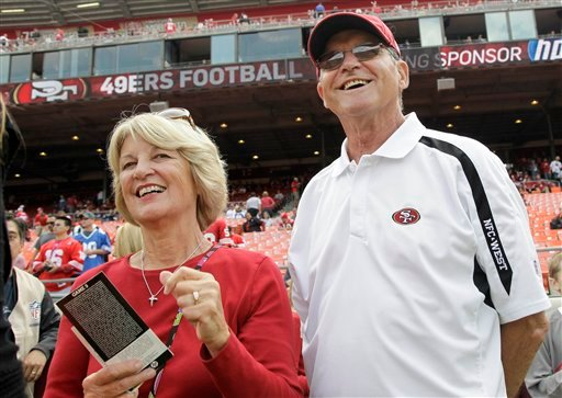   In this Sept. 11, 2011 file photo, Jackie and Jack Harbaugh, parents of San Francisco 49ers coach Jim Harbaugh and Baltimore Ravens coach John Harbaugh, stand before an NFL football game between the 49ers and the Seattle Seahawks in San Francisco.