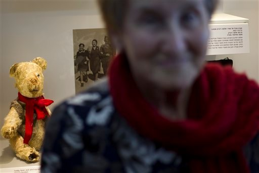 © Holocaust survivor Stella Knobel, poses next to her teddy bear during a new exhibition of Israel's national Holocaust memorial and museum in Jerusalem, Sunday, Jan. 27, 2013.