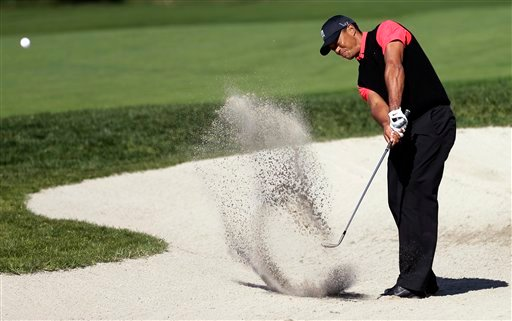  Tiger Woods hits out of a bunker on the 10th hole during the fourth round of the Farmers Insurance Open golf tournament at the Torrey Pines Golf Course, Monday, Jan. 28, 2013, in San Diego.