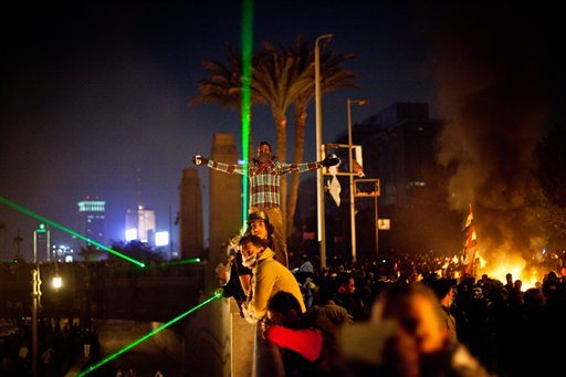 © In this Sunday, Jan. 27, 2013 photo, protesters clash with security forces near Tahrir Square in Cairo, Egypt.