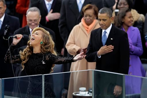 ©  In this Jan. 21, 2013 file photo, President Barack Obama as Beyonce sings the national anthem at the ceremonial swearing-in at the U.S. Capitol during the 57th Presidential Inauguration in Washington.