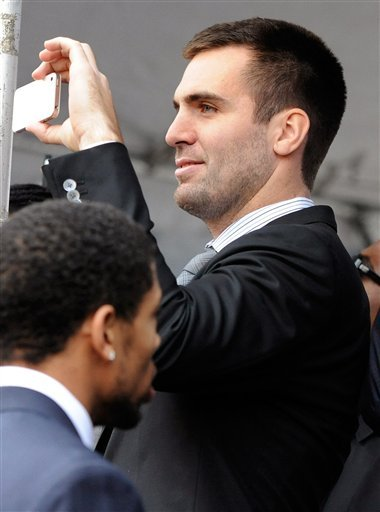 Baltimore Ravens quarterback Joe Flacco records a send-off rally for the team on Monday, Jan. 28, 2013 in Baltimore. The NFL football team is leaving for New Orleans to face the San Francisco 49ers in the Super Bowl. (AP Photo/Steve Ruark)