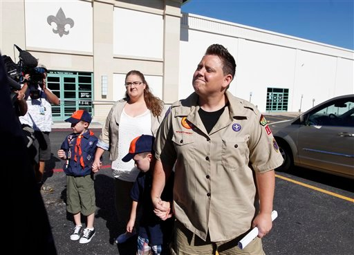 © In this July 18, 2012 file photo, Jennifer Tyrrell, right, arrives for a meeting at the Boys Scouts of America national offices in Irving, Texas, with her son Jude Burns, 5, second from right, partner Alicia Burns, and son Cruz Burns, 7, left.