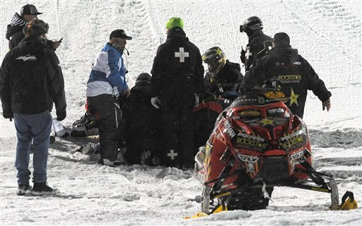 In this photo taken Jan. 24, 2013, emergency personnel tend to Caleb Moore after he crashed during the snowmoblie freestyle event at the Winter X Games in Aspen, Colo. (AP Photo/The Colorado Springs Gazette, Christian Murdock)