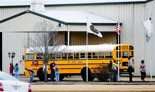 In this Tuesday, Jan 29, 2013 photo, residents look over the school bus where a shooting occurred near Destiny Church along U.S. 231, just north of Midland City, Ala. on Tuesday. (AP Photo/The Dothan Eagle, Danny Tindell)