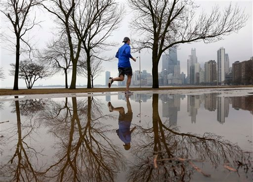 A lone jogger makes his way along Lake Michigan in unseasonably warm temperatures at Chicago's North Ave. (AP Photo/Charles Rex Arbogast)