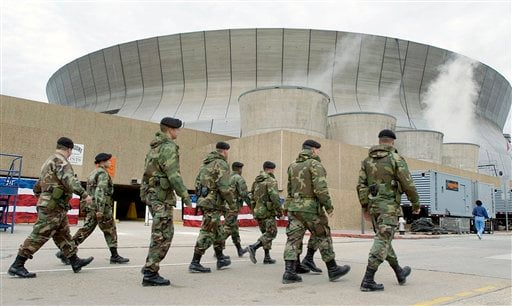 In this Friday, Feb. 1, 2002 file photo, National Guardsmen patrol the Louisiana Superdome in New Orleans. (AP Photo/Amy Sancetta, File)