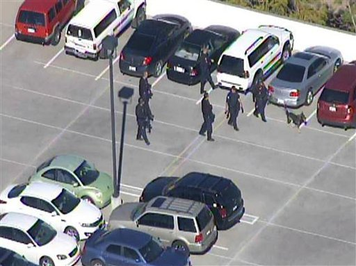 This frame grab provided by abc15.com shows the scene at a Phoenix office complex where police say a gunman shot at least three people on Wednesday, Jan. 30, 2013. (AP Photo/abc15.com)
