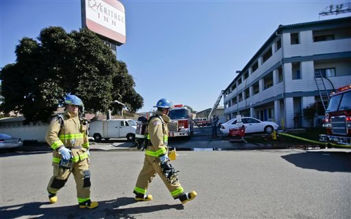 Firefighters respond to the Heritage Hotel after an explosion on Wednesday, Jan. 30, 2013, in San Diego.