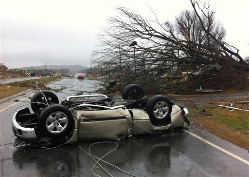 A vehicle lies on a road after a tornado moved through Adairsville, Ga. on Wednesday, Jan. 30, 2013. (AP Photo/David Goldman)