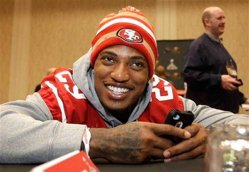 San Francisco 49ers cornerback Chris Culliver talks with teammates during a media availability Wednesday, Jan. 30, 2013, in New Orleans. (AP Photo/Mark Humphrey)