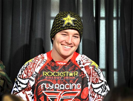 In this photo taken Jan. 25, 2012 and released by ESPN Images, snomobiler Caleb Moore smiles while attending a news conference at the Winter X Games in Aspen, Colo.
