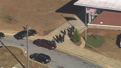 In this image made from video and released by WSB-TV, authorities investigate the scene of a school shooting, Thursday, Jan 31, 2013 in Atlanta.  (AP)