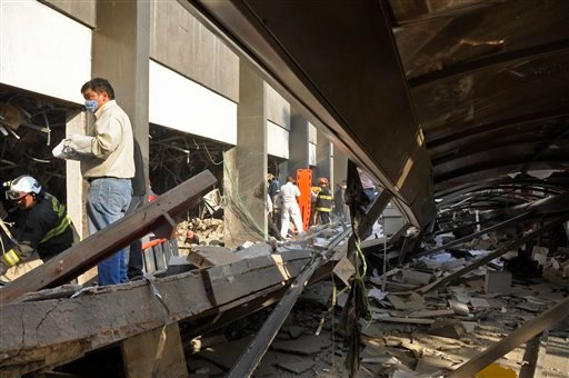 Firefighters belonging to the Tacubaya sector and workers dig for survivors after an explosion at a building adjacent to the executive tower of Mexico's state-owned oil company PEMEX, in Mexico City, Thursday Jan. 31, 2013. (AP)