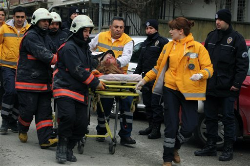 © Medics carry an injured woman on a stretcher to an ambulance after a suspected suicide bomber detonated an explosive device at the entrance of the U.S. Embassy in the Turkish capital, Ankara, Turkey, Friday Feb. 1, 2013.