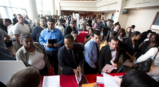 In this Tuesday, Jan. 22, 2013 photo, job seekers fill a room at the job fair in Sunrise, Fla.  (AP)