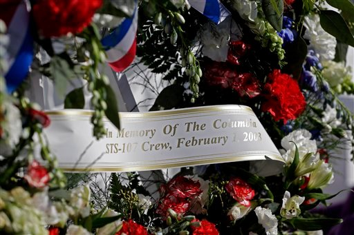 A wreath placed at the Space Mirror Memorial is seen during a remembrance ceremony on the 10th anniversary of the loss of space shuttle Columbia crew at the Kennedy Space Center Visitor Complex, Friday, Feb. 1, 2013, in Cape Canaveral, Fla. (AP)