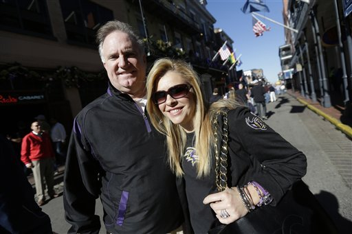 In this Friday, Feb. 1, 2013 photo, Sean and Leigh Anne Tuohy, adoptive parents of Baltimore Ravens starting offensive lineman Michael Oher, stand on a street in New Orleans. (AP Photo/Gerald Herbert)