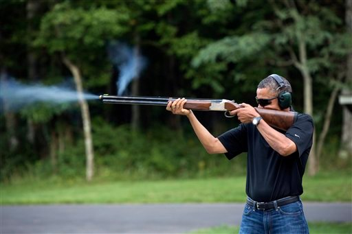 In this photo released by the White House, President Barack Obama shoots clay targets on the range at Camp David, Md., Saturday, Aug. 4, 2012. (AP Photo/The White House, Pete Souza)