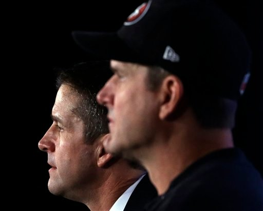  San Francisco 49ers head coach Jim Harbaugh and Baltimore Ravens head coach John Harbaugh participate in a news conference for the NFL Super Bowl XLVII football game Friday, Feb. 1, 2013, in New Orleans.