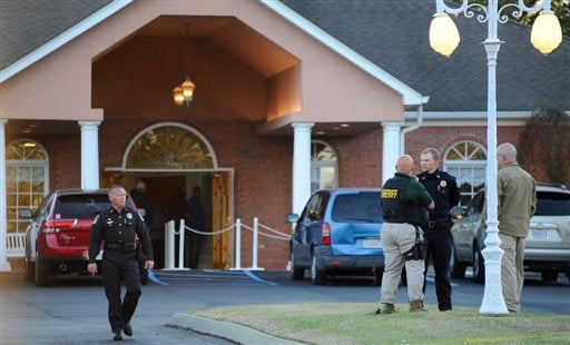  Law enforcement personnel wait outside the funeral home as people pay their respects to Charles Albert &quot;Chuck&quot; Poland, the 66 year old bus driver who gave his life to save the children on his bus, Saturday, Feb. 2, 2013 in Slocumb, Ala.