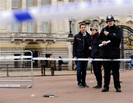 © A cornered off area containing knives, a hat and Taser wire outside Buckingham Palace in central London after a man armed with two knives was stunned by police, Sunday Feb. 3, 2013.