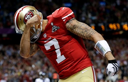 © San Francisco 49ers quarterback Colin Kaepernick celebrates his touchdown against the Baltimore Ravens during the second half of the NFL Super Bowl XLVII football game, Sunday, Feb. 3, 2013, in New Orleans. (AP Photo/Dave Martin)