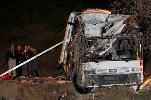 © Investigators continue working the scene where at least eight people were killed and 38 people were injured after a tour bus carrying Mexican tourists careened out of control while traveling down a mountain road.