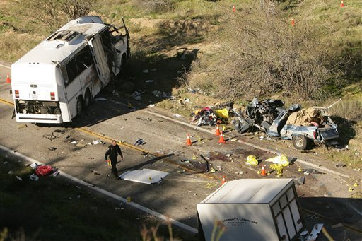 Investigators continue to work the scene of a bus crash that happened overnight on Highway 38 that killed at least 8 people on Monday, Feb. 4, 2013.