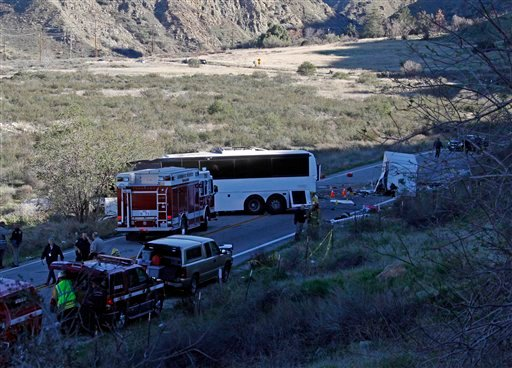 Authorities continue their investigation of the scene where at least eight people were killed and 38 were injured after a tour bus carrying a group from Tijuana, Mexico crashed with two other vehicles just north of Yucaipa, Calif.