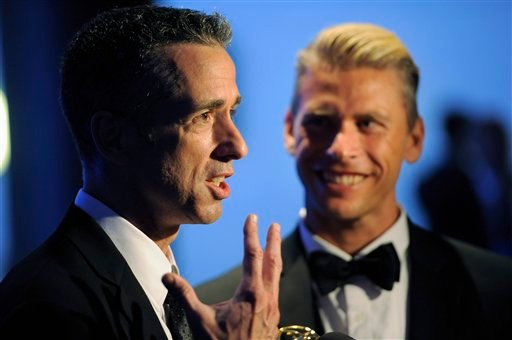 "©  In this Sept. 15, 2012 file photo, Dan Savage, left, and Terry Miller pose backstage with the Governors Award for the ""It Gets Better Project"" at the 2012 Creative Arts Emmys at the Nokia Theatre in Los Angeles."