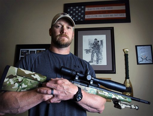 "© In this April 6, 2012, photo, former Navy SEAL and author of the book ""American Sniper"", Chris Kyle poses in Midlothian, Texas."
