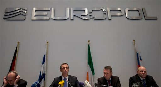 Britain's Rob Wainwright, second from left, director of the European police agency Europol, elaborates on findings of a probe into match fixing during a press conference in The Hague, Netherlands, Monday Feb. 4, 2013.